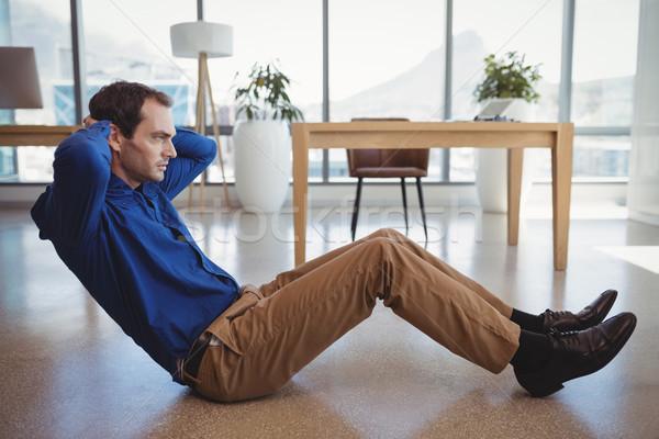 Determinado executivo homem fitness tabela azul Foto stock © wavebreak_media