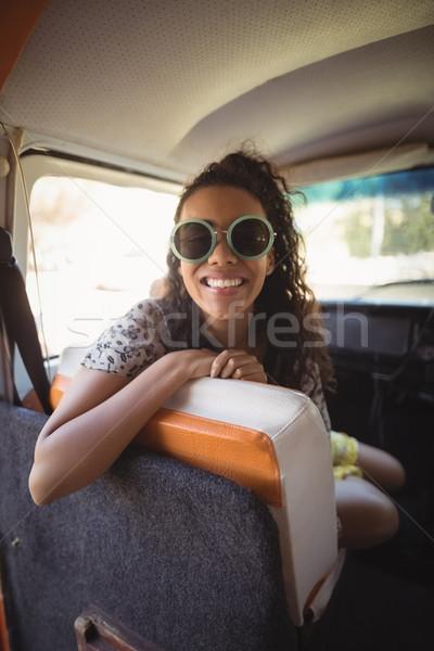 Joyful woman sitting in van Stock photo © wavebreak_media