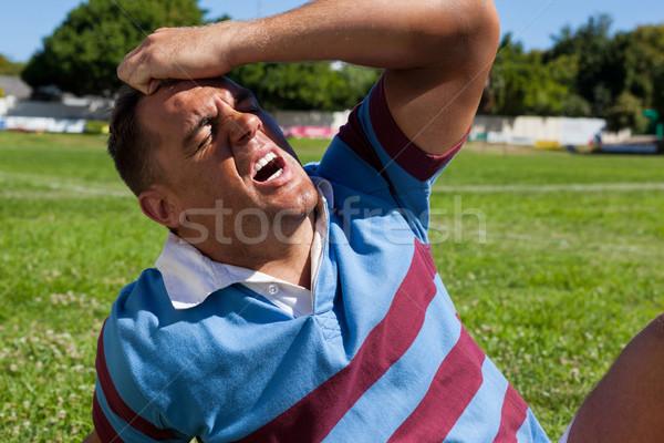 Infeliz rugby jogador sessão campo Foto stock © wavebreak_media