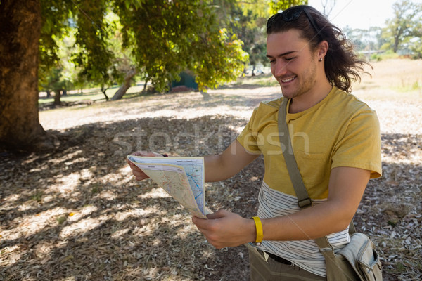 Tourist man looking at map in the park Stock photo © wavebreak_media