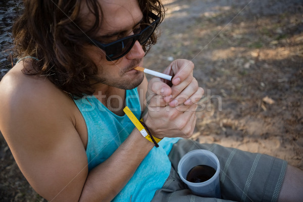 Man smoking cigarette in the park Stock photo © wavebreak_media
