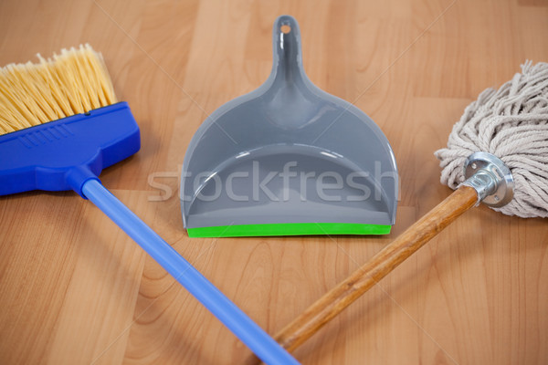 Dustpan, sweeping broom and mop on wooden floor Stock photo © wavebreak_media