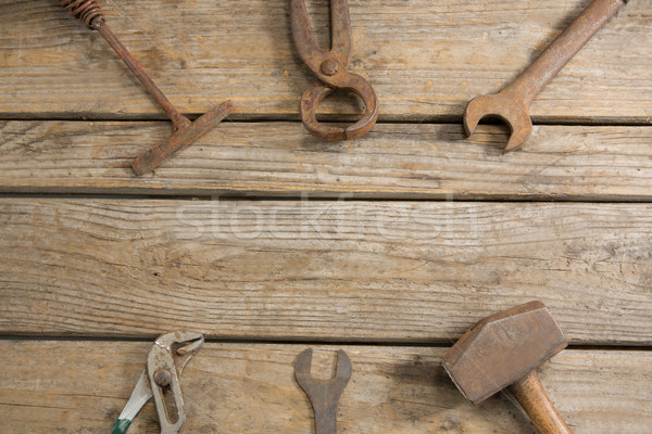 Overhead view of rusty work tools on table Stock photo © wavebreak_media