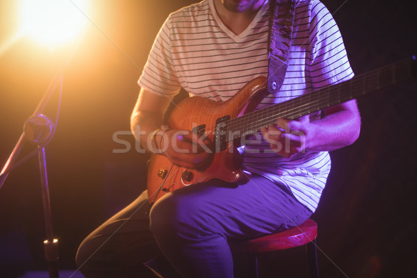 Mid section of singer playing guitar in nightclub Stock photo © wavebreak_media