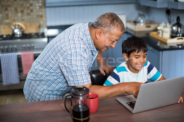 High angle view of grandfather assisting grandson using laptop Stock photo © wavebreak_media
