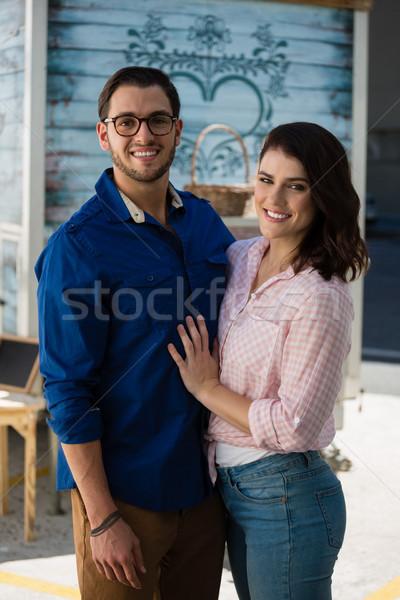 Happy couple standing at cafe Stock photo © wavebreak_media