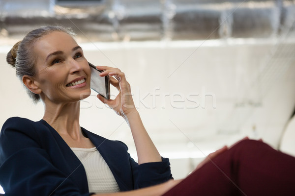 Businesswoman communicating on smart phone at office Stock photo © wavebreak_media