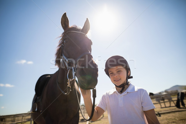 Rider girl standing with a horse in the ranch Stock photo © wavebreak_media