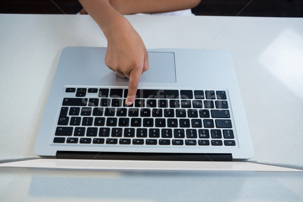 High angle view of girl pressing key on laptop Stock photo © wavebreak_media