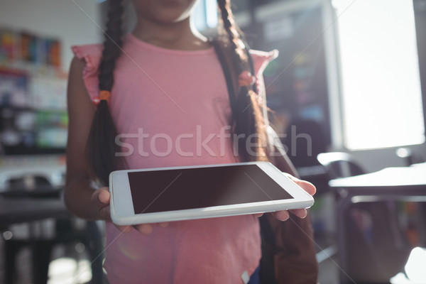 Midsection of girl using digital tablet Stock photo © wavebreak_media