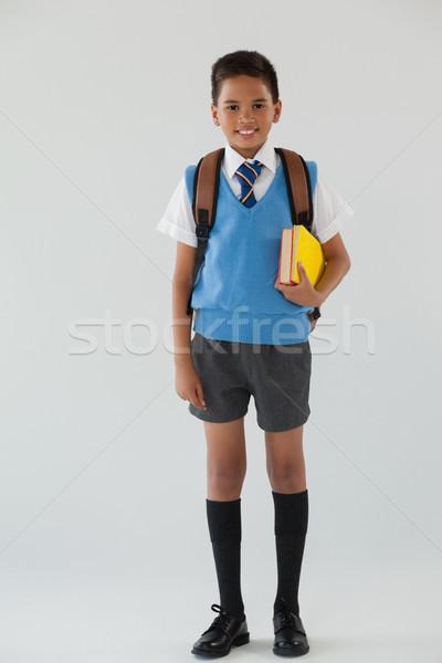 écolier uniforme scolaire école sac blanche portrait Photo stock © wavebreak_media