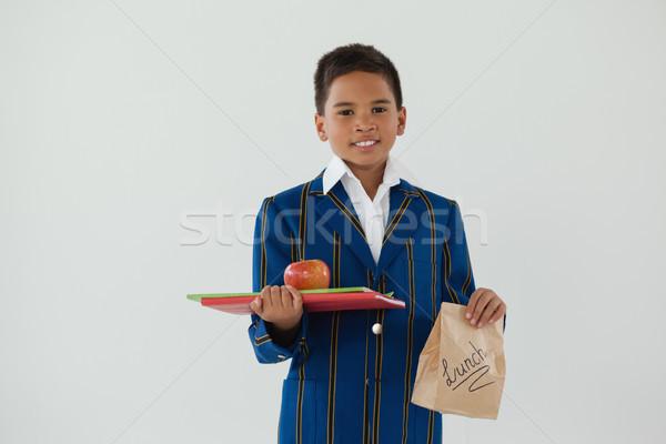 Scolaro mela libri usa e getta pranzo Foto d'archivio © wavebreak_media