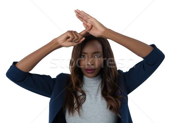 портрет деловая женщина рукой знак белый женщину Сток-фото © wavebreak_media