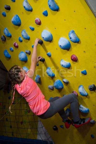 Teenage girl practicing rock climbing Stock photo © wavebreak_media