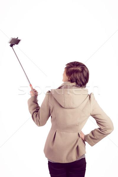Attractive woman taking a selfie Stock photo © wavebreak_media