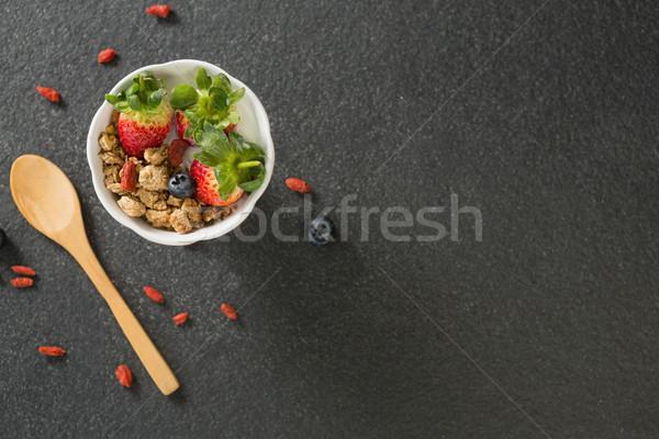 Bol déjeuner céréales fruits spatule noir Photo stock © wavebreak_media