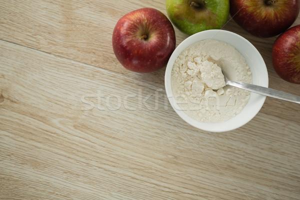 Diretamente acima tiro farinha tigela maçãs Foto stock © wavebreak_media