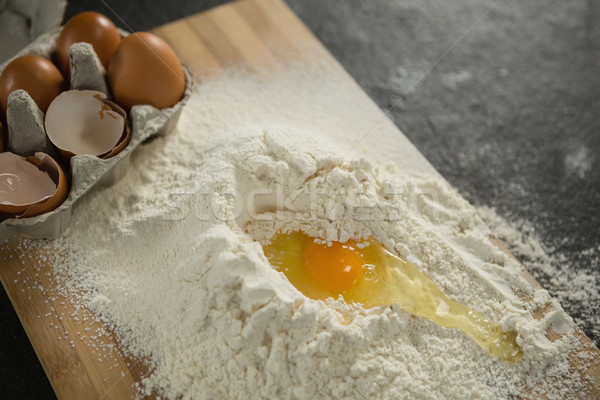 High angle view of egg yolk in flour ny carton on cutting board Stock photo © wavebreak_media