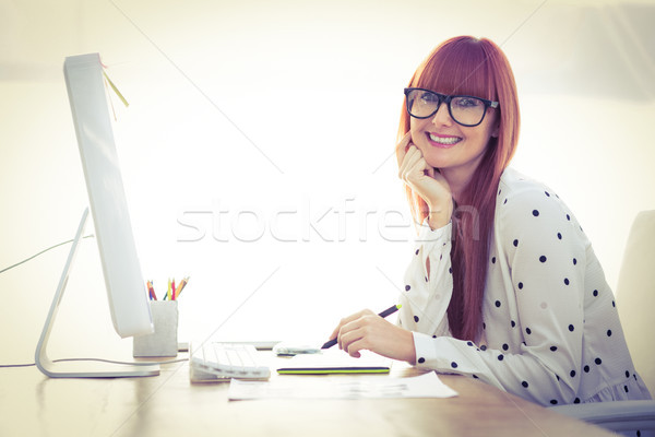 Attractive hipster woman using graphics tablet  Stock photo © wavebreak_media
