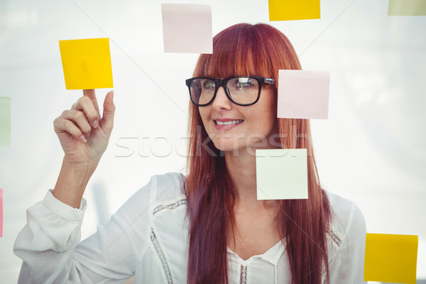 Attractive hipster woman pointing sticky notes Stock photo © wavebreak_media