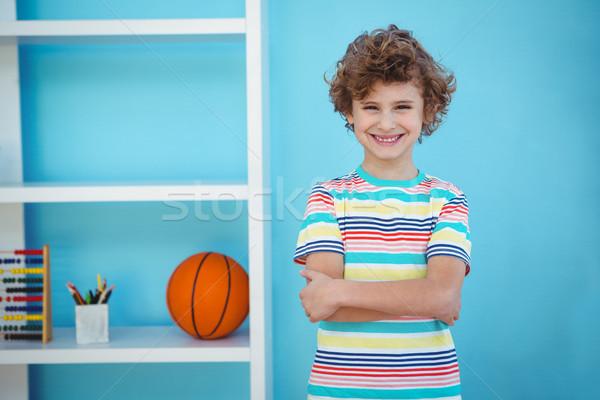 Smiling boy standing beside some toys Stock photo © wavebreak_media