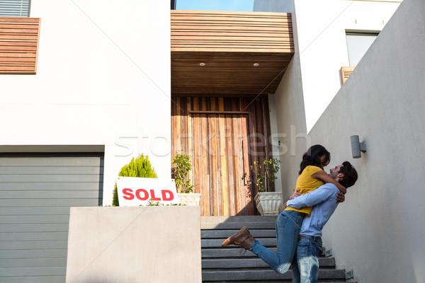 Happy couple hugging in front of new house Stock photo © wavebreak_media