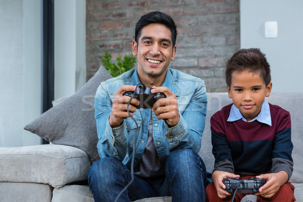 Happy father playing video games with his son Stock photo © wavebreak_media