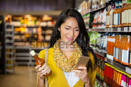 Pretty woman thinking with hand on chin Stock photo © wavebreak_media