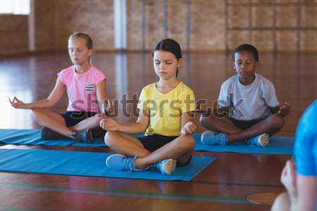 Instructor training students in practicing cobra pose at health club Stock photo © wavebreak_media
