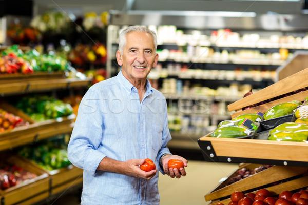 улыбаясь старший человека из помидоров Сток-фото © wavebreak_media