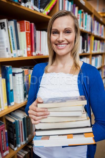 Boldog női diák elvesz könyvek könyvtár Stock fotó © wavebreak_media