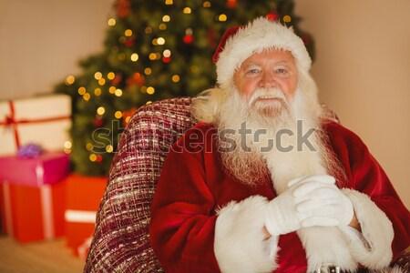 Surprise santa claus opening gift sack in living room Stock photo © wavebreak_media