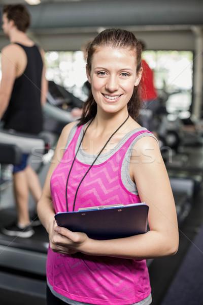 Női edző mosolyog kamerába crossfit tornaterem Stock fotó © wavebreak_media
