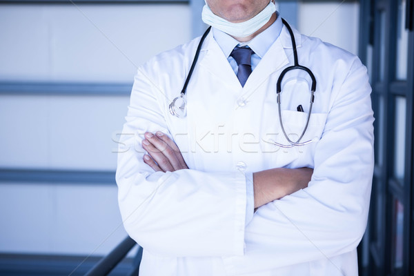 Male doctor standing with arms crossed Stock photo © wavebreak_media