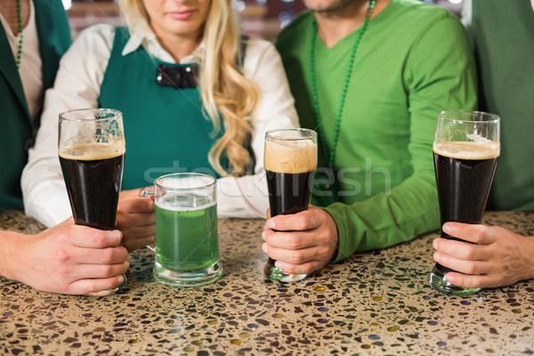 Friends holding beers Stock photo © wavebreak_media