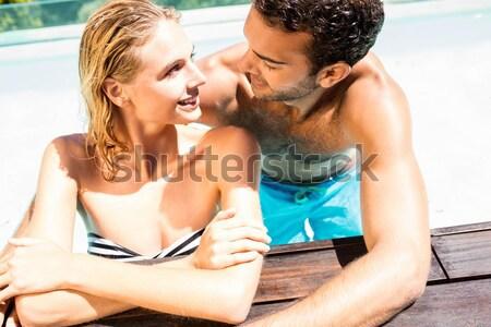 Mosolyog pár ül függőágy tengerpart tenger Stock fotó © wavebreak_media