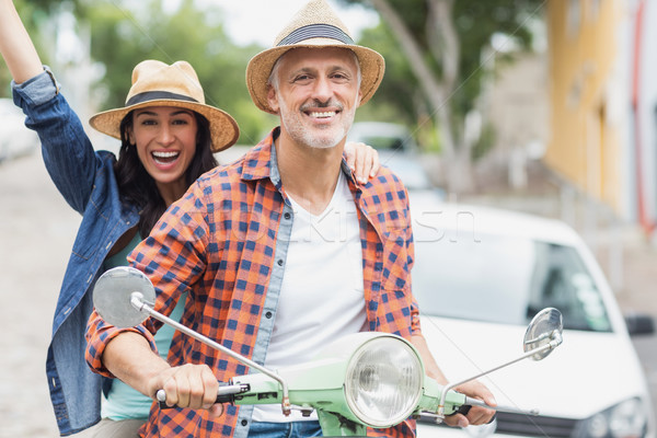 Stock photo: Portrait of man riding moped with excited woman