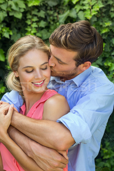 Romantic man kissing woman at front yard Stock photo © wavebreak_media