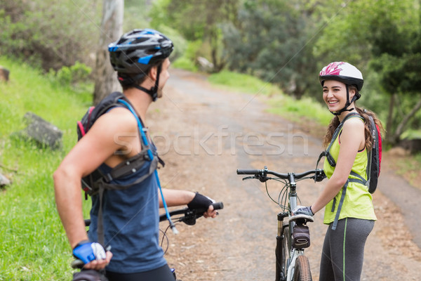 Stock photo: Happy couple with bikers on footpath