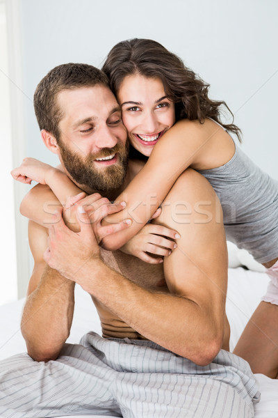 Young couple embracing on bed Stock photo © wavebreak_media