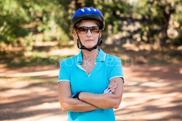 Mature bike rider woman posing with arms crossed Stock photo © wavebreak_media