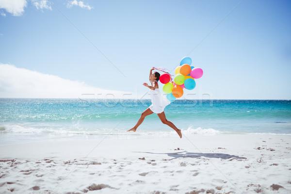 Mujer hermosa globo playa feliz mar Foto stock © wavebreak_media
