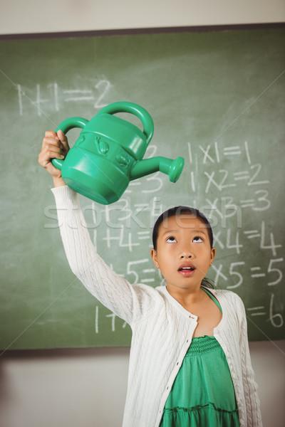 Colegiala regadera verde aula agua escuela Foto stock © wavebreak_media