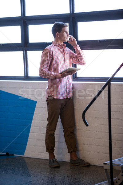 Portrait of young businessman having a phone call Stock photo © wavebreak_media