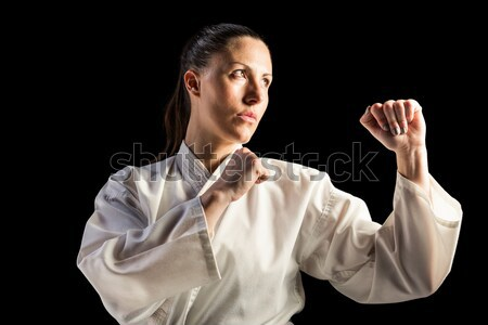 Női vadászrepülő előad karate hozzáállás fekete Stock fotó © wavebreak_media