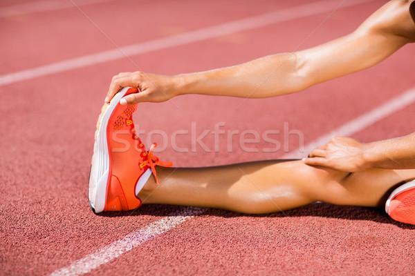 Femenino atleta hasta ejecutando tema Foto stock © wavebreak_media