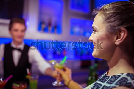 Barman serving cocktail to woman Stock photo © wavebreak_media