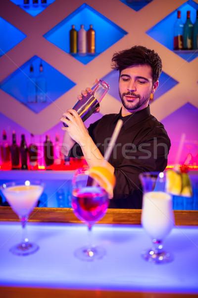 Bartender with cocktail shaker at bar counter Stock photo © wavebreak_media