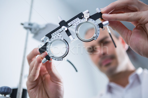 Close-up of optometrist holding messbrille Stock photo © wavebreak_media