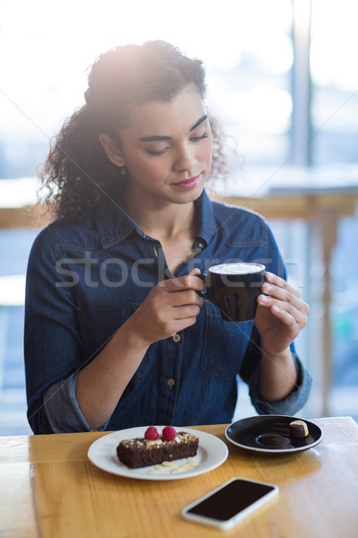 Woman having a cup of coffee in café Stock photo © wavebreak_media